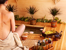 Bamboo massage at spa . Royalty Free Stock Image