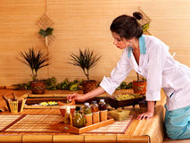 Bamboo massage at spa. Bamboo massage at spa and woman Stock Photography