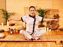 Bamboo massage at spa and woman. Royalty Free Stock Image