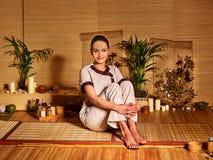 Bamboo massage at spa and woman Royalty Free Stock Photos