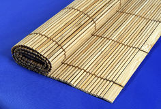 Bamboo mat. Isolated on blue Royalty Free Stock Images