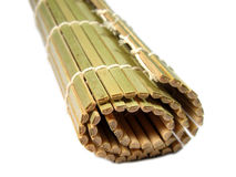 Bamboo mat. This is a special Japanese bamboo tool used to roll the sushi rolls.It is called makita.Photographed over white with short artistic doff Stock Images
