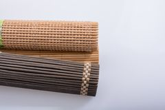 Bamboo mat as straw abstract texture. Pattern royalty free stock photo