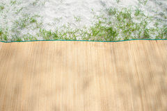 Bamboo mat on the beach. With grass Royalty Free Stock Photo