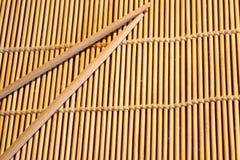 Bamboo mat and chopsticks Royalty Free Stock Photos