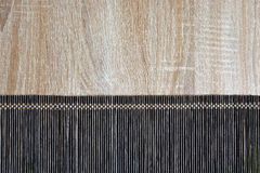 Bamboo mat close up on wooden background Royalty Free Stock Images