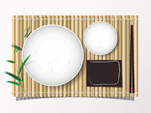 Bamboo mat and dish and chopsticks set lunch top view bakcground Royalty Free Stock Image