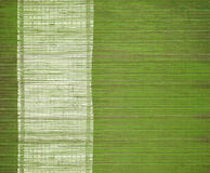 Bamboo mat with grunge white menu bar Royalty Free Stock Images