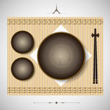 Bamboo mat with plates and chopsticks setting for lunch  Stock Images