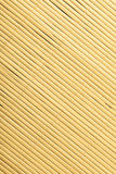 Bamboo mat surface pattern diagonal background texture Royalty Free Stock Photography