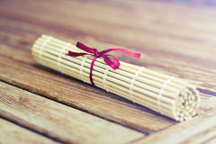 Bamboo mat for sushi with a bow Stock Photo