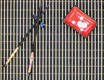Bamboo mat, sushi sticks, sauce bowl, top view royalty free stock photos