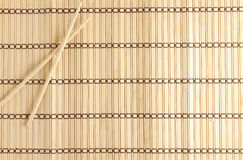 Bamboo Mat for sushi with wooden chopsticks Royalty Free Stock Photography