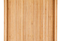 Bamboo mat twisted in the form of a manuscript, Isolated Stock Image