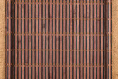 Bamboo mat twisted in the form of a manuscript on sackcloth Stock Images