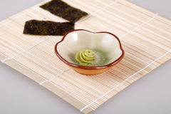 A bamboo mat and two laver and wasabi Stock Image