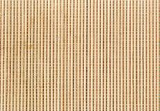 Bamboo mat used for rolling maki sushi. Close up of bamboo mat background. Close up macro of beige brown bamboo mat as striped background. Closeup of makisu Stock Photography