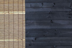 Bamboo mat on wooden table, top view royalty free stock images
