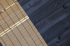 Bamboo mat on wooden table, top view stock image