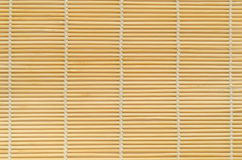 Bamboo mat. Wooden bamboo mat yellow closeup Royalty Free Stock Images