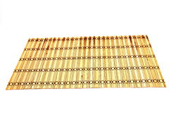 Bamboo mats against the white background Stock Photos