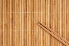 Bamboo napkin and chopsticks Royalty Free Stock Images