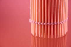Bamboo napkin in a roll. Put vertically and removed close up with use of the red filter Royalty Free Stock Photography