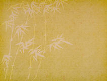 Bamboo on old grunge paper background Stock Photography