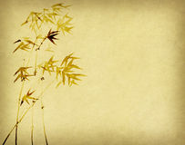 Bamboo on old grunge paper background Stock Photos