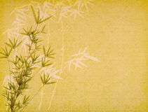 Bamboo on old grunge paper background Stock Photo