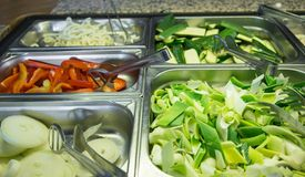Bamboo and onion in the buffet pans in Asian restaurant Stock Photography