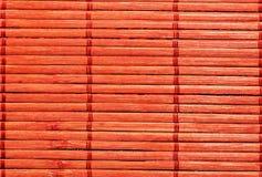 Bamboo orange background. Decorative bamboo plaque striped background Royalty Free Stock Image