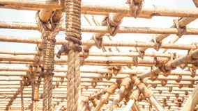 Bamboo panel with a rope tied construction design idea for sustainable eco green world royalty free stock image