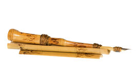 Bamboo pen. Isolated on the white background Royalty Free Stock Photo