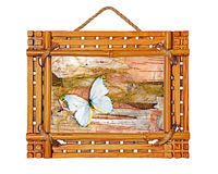 bamboo photo frame with abstract composition of butterflies, bi Stock Photos