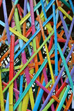 Bamboo pieces cut to length and colorful painted. Stock Photo
