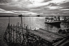 Bamboo pier and fishing boat Stock Photography