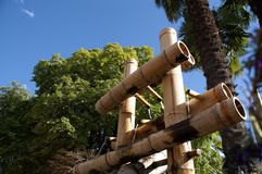Bamboo pipes. A display of bamboo pipes on a water fountain royalty free stock image