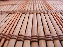 Bamboo Place Mat. Brown, striped table mat made from strips of bamboo strung together Stock Image