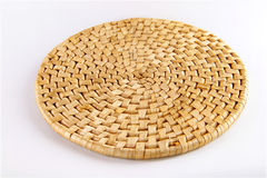 Bamboo place mat on white. Bamboo place mat isolated on white. Concept of household item royalty free stock photography