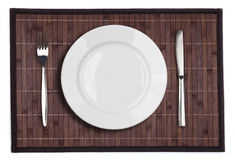 Bamboo placemat with plate fork and knife Stock Photography