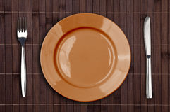 Bamboo placemat with plate fork and knife Royalty Free Stock Photo