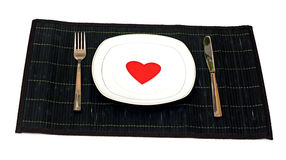 Bamboo placemat with plate fork and knife Royalty Free Stock Images