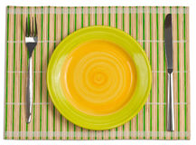 Bamboo placemat with plate fork, knife top view Stock Images