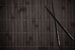 Bamboo placemat with sticks royalty free stock images