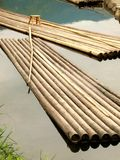 Bamboo raft. Raft docked at the river bank Royalty Free Stock Images