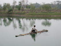 Bamboo Raft. Fisherman in a bamboo raft. Taken at a river in Guilin, China Royalty Free Stock Photo