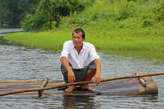 Bamboo raft, China. Man resting on a bamboo raft in Yulong river, in Yangshuo, China stock photography