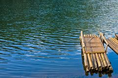 Bamboo raft floating on blue calm water in Pang-Oong reserve Stock Photos