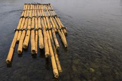 Bamboo raft. Floating in river Royalty Free Stock Image